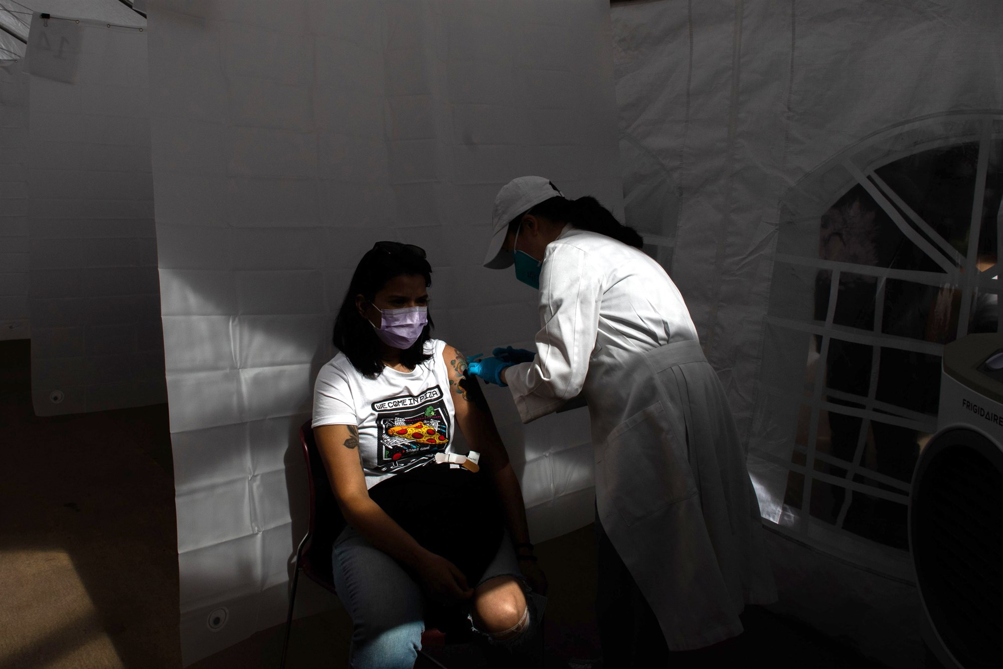 A nurse administers the Moderna Covid-19 vaccine at Kedren Community Health Center in Los Angeles on Feb. 16.